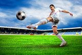 Fototapeta Happiness football player after goal on the field of stadium wit